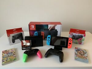 Nintendo Switch Console Neon Red & Blue 256 GB Card 2 Games 2 Pro Controllers