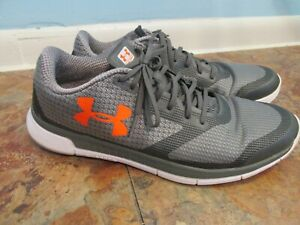 Under Armour Mens CHARGED LIGHTNING Running Shoes GREY orange