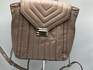 Michael Kors medium pink backpack with gold colored latch and handle. $40.00