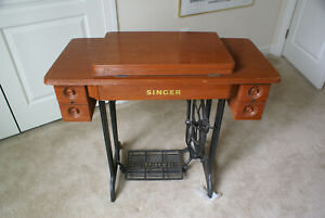 Sewing Machine Singer antique with wood cabinet for parts. Local pickup only. $79.00