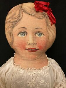 Large Antique Printed Cloth Doll with antique Clothing.. $250.00