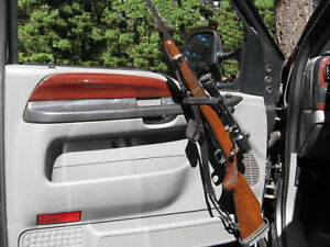 TRUCK INTERIOR DOOR GUN MOUNTING RACKS