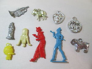 lot of small cracker jack charms cow boy plastic