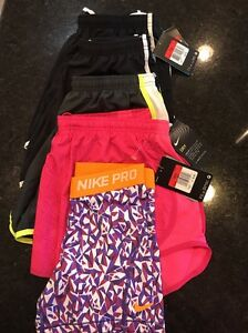 NEW Lot of 5 pairs of Nike Girls shorts4 dry fit shorts 1 Nike pro shorts sz L