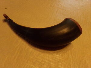 black powder hunting horn made from a bison horn with walnut caps.