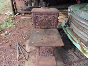 antique wood cook stove very ornate and all cast iron. good condition all there