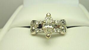 14k. white gold marquise diamond solitaire with accents engagement ring. 1.00