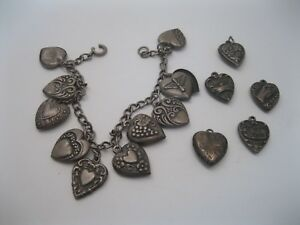 Lot 76 - Collection 15 Old Sterling Silver Puffy Heart Charms  Charm Bracelet