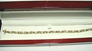 14k. yellow gold 42 round brilliant cut diamond tennis bracelet.