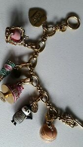 Royal Juicy Couture Gold Toned Charm Bracelet Includes Five Charms and Heart