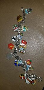 Vintage Sterling Silver 17 charm bracelet with enamel European charms.