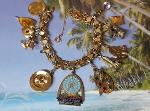 Gold Tone Monet Charm Bracelet with 11 Charms