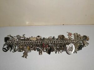 LARGE HEAVY ALL STERLING SILVER CHARM BRACELET WITH 72 CHARMS. 160.30-GRAMS