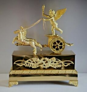Cupid on a Chariot Empire period 19th century Gilded Bronze Clock