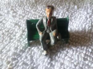 Vintage USA Man Sitting on Bench - Antique Lead Toy