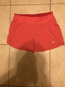 WOMENS NIKE DRI FIT TEMPO RUNNING SHORTS SIZE:Medium Color:Coral. Fully Lined. $10.50