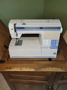 VIKING HUSQVARNA # 1 sewing machine come with wood cabinet used $620.00