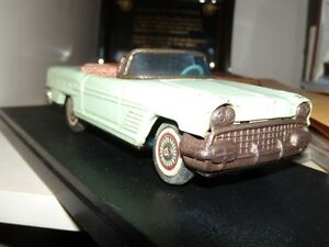 1958 pontiac convertible friction tin toy