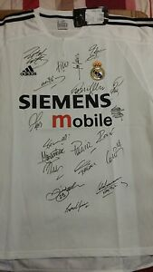 Real Madrid home shirt 2003-2004 signed by 19. Short sleeved tagged