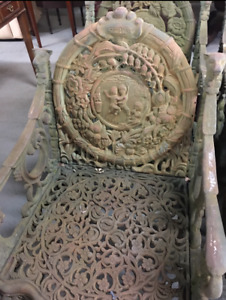 Antique Four Seasons Cast Iron Chairs