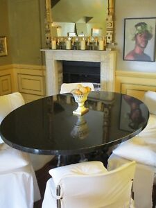 BLACK GRANITE DINING TABLE by Viktor Tinkl.