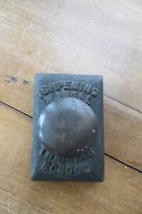 Vintage lead paper weight for Ishpeming Manual Training School old heavy