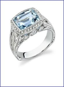 Gorgeous 18K White Gold Designer Ring with .55cts & 2.75ct Center