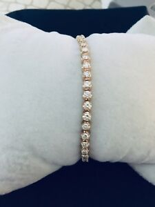 Ladies 14K solid yellow gold and Diamond tennis bracelet