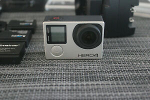 GoPro Hero 4 Silver LOT 4KWiFiBluetooth w 3 Batteries and Much More!