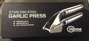 Garlic Press. Stainless Steel Mincer & Silicone Roller Peeler. Easy Squeeze.