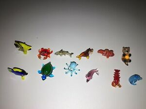 Looking Glass Torch Sculptures includes 12 from Ocean theme EUC