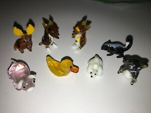 Looking Glass Torch Sculptures includes 8 from Animals theme EUC