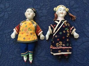 Pair of porcelain cloth Chinese dolls $25.00