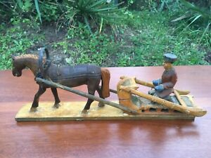ANTIQUE WOODEN CARVED MAN ON SLED WITH HORSE HAND CARVED VERY OLD $49.95
