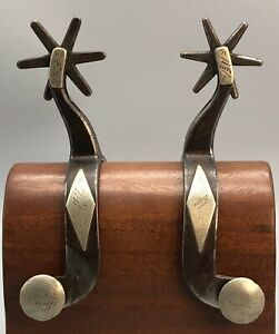 An Great Old Collectable Pair of Kelly Bros Spurs With Diamond Pattern