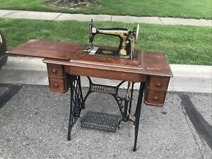 singer treadle sewing machine in cabinet $250.00