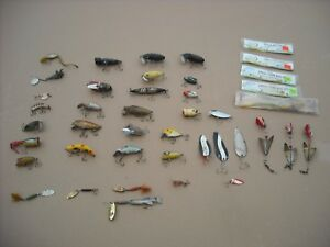 Vintage fishing lures lot. Heddon and wood lures.