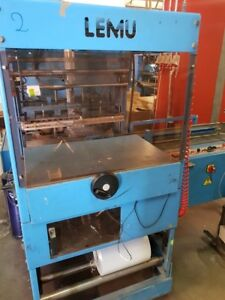 AUTOMATIC SHRINK FILM PACKAGING SYSTEM FOR POS-LOTTERY
