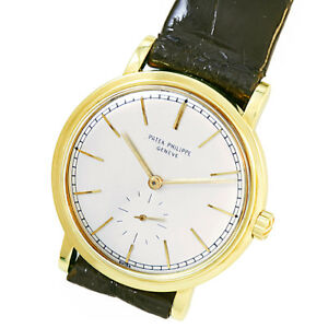 PATEK PHILIPPE LUXURY DRESS WATCH  18K YELLOW GOLD 37 JEWEL AUTOMATIC WIND