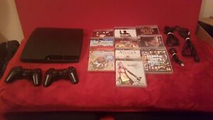 Sony PlayStation 3 - Slim 160GB + 10 Games 2 Controllers and PlayStation Eye