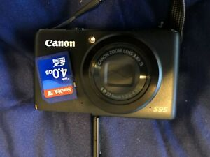 Canon PowerShot S95 10 MP Digital Camera + Battery + Charger + Case