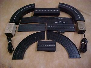 ho slot car track plus 2 transformers