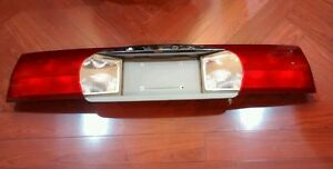 2002-2007 GM BUICK RENDEZVOUS REAR CENTER HATCH TAIL LIGHT LAMP LAMPS LENS OEM