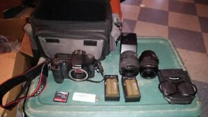 Canon EOS 50D 15.1MP Digital SLR Camera with 18-200 lensand extras.