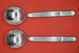 World, stainless # 237, Apollo pattern, pair of round cream soup spoons