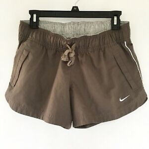 NIKE The Athletic Dept Womens Shorts Size M Running Jogging Brown Pockets