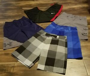 UNDER ARMOUR LOT OF 4 SHORTS AND 1 PAIR OF NIKE BLACKRED PANTS KIDS MEDIUM