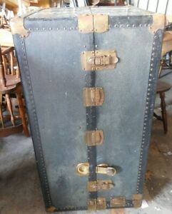Antique steamer trunk wardrobe with dresser drawers and hangers