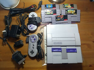 Super Nintendo Entertainment System w Controllers and Games (Super Mario Kart)
