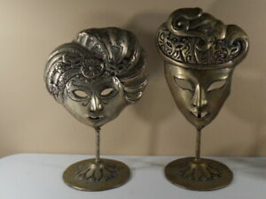 Pair of Masquerade Mask Cast Metal Sculptures $220.00
